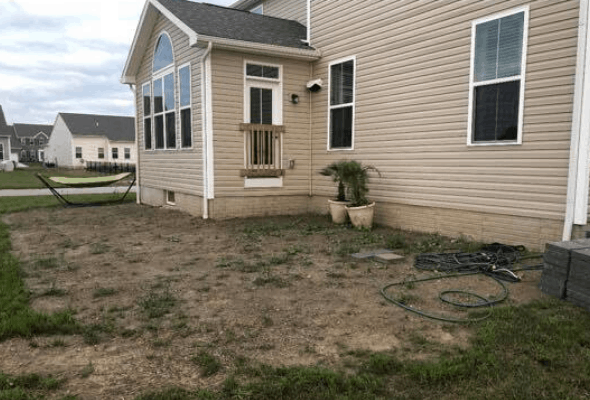 Surge Construction and Restoration patio before image