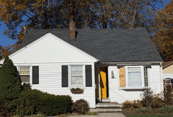 Surge Construction and Restoration storm damage restoration on roof after